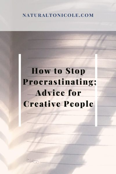 Blank lined note book with sunlight, how to stop procrastinating;advice for creative people title
