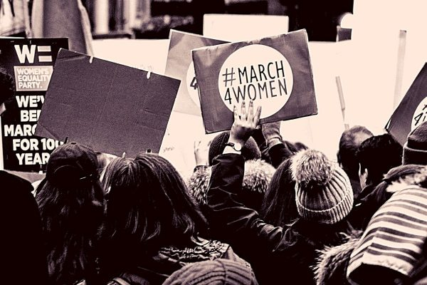 Confident women protesting and a Women's Equality Party sign