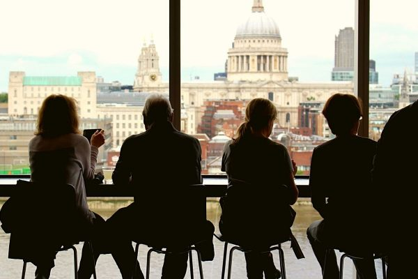 quiet people in silhouette in a cafe looking out at St Paul's London