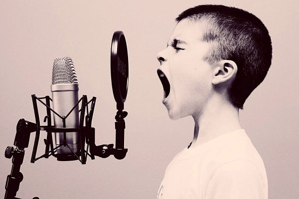 Confident child at microphone