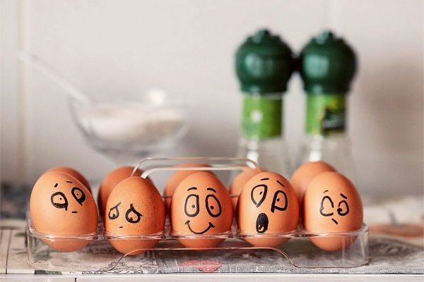 Eggs with faces displaying positive and negative emotions